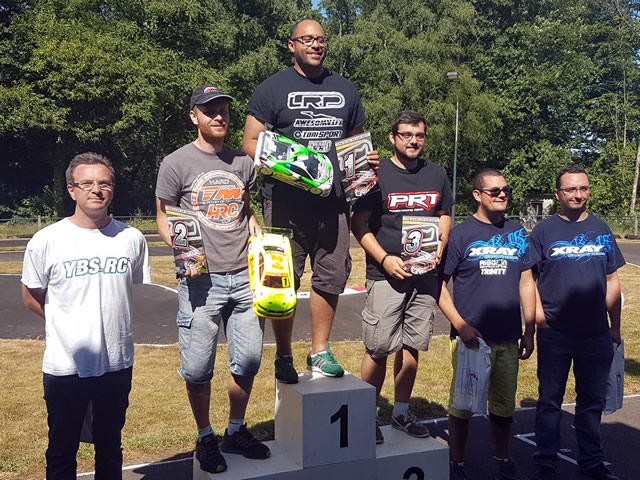 Two Team Magic E4RS III Plus on the podium at French Nats, with Vigneron & Callens